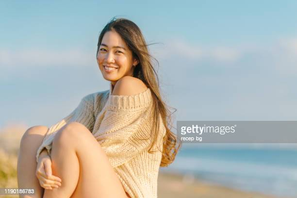 portrait of young woman in knitted sweater and bikini - beautiful beach babes stock pictures, royalty-free photos & images