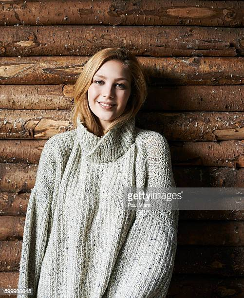 portrait of young woman in large cosy jumper