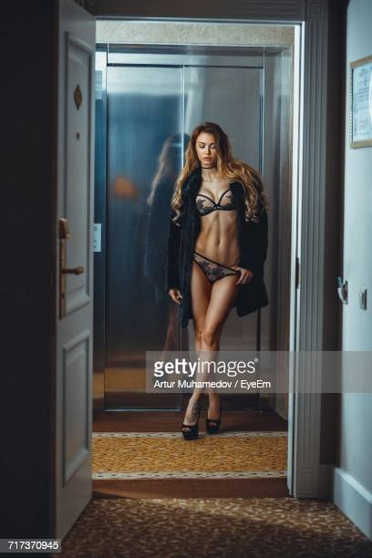 portrait of young woman in lingerie - dessous stock-fotos und bilder
