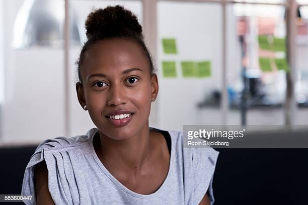 portrait of young woman in meeting room - topknot stock pictures, royalty-free photos & images