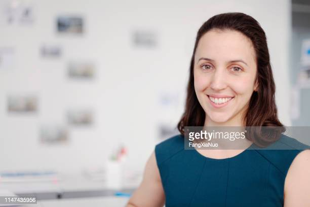 portrait of young woman in modern design studio office - museum curator stock pictures, royalty-free photos & images