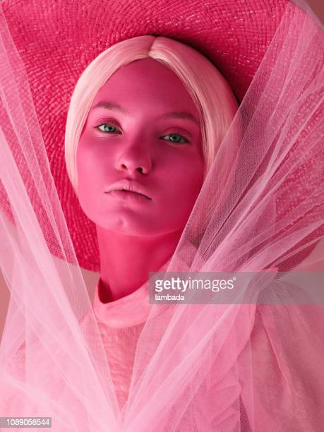 portrait of young woman in monochrome pink tones - colour block stock pictures, royalty-free photos & images