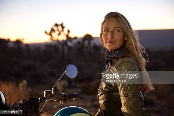 Portrait of young woman in motorcycle jacket