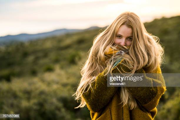 portrait of young woman in nature - coat fotografías e imágenes de stock