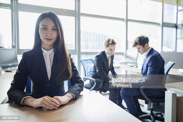 portrait of young woman in office - good posture stock pictures, royalty-free photos & images