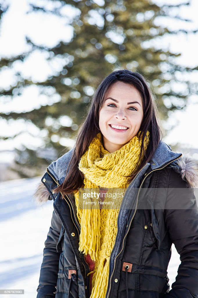 Portrait of young woman in overcoat : Stock Photo