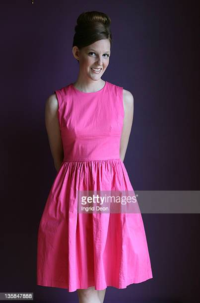 portrait of young woman in pink dress with beehive - beehive hair stock pictures, royalty-free photos & images