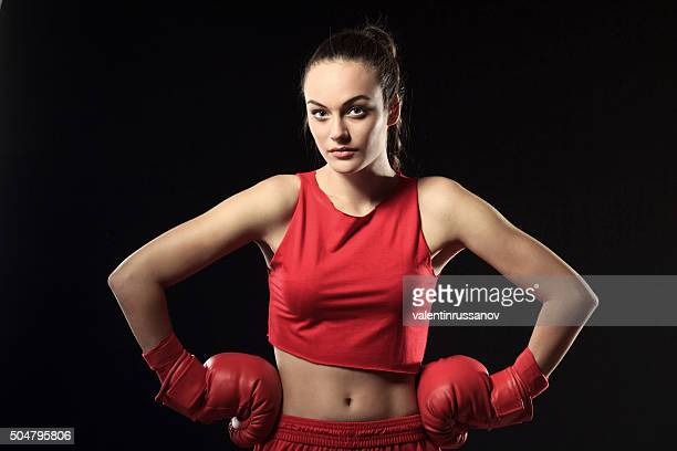 Portrait Of Young Woman in Red Boxing Outfit