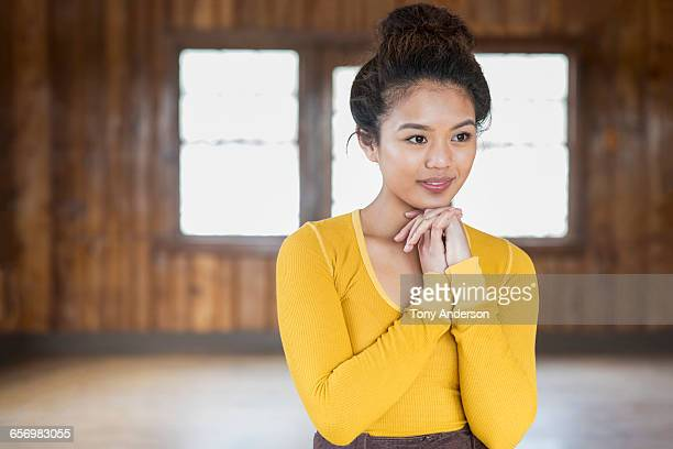 portrait of young woman in rustic lodge - sleeve stock photos and pictures