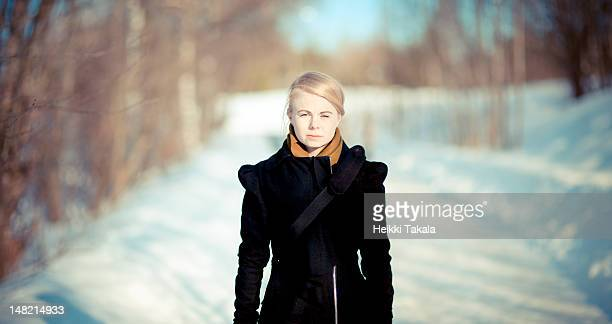 portrait of young woman in snow path - tampere finland stock pictures, royalty-free photos & images