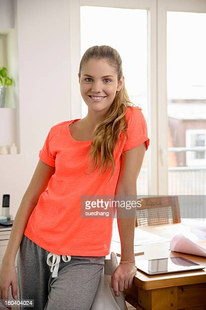 Portrait of young woman in sports wear at home