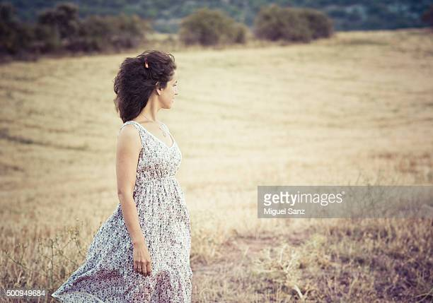 Portrait of young woman in straw field
