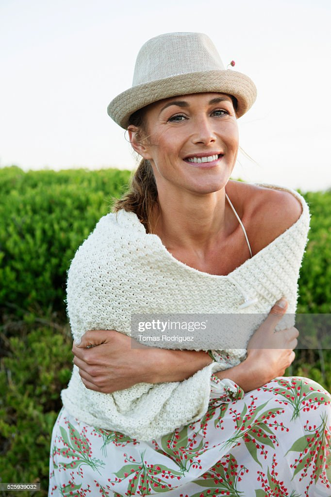 Portrait of young woman in summer clothes and hat : Stock Photo