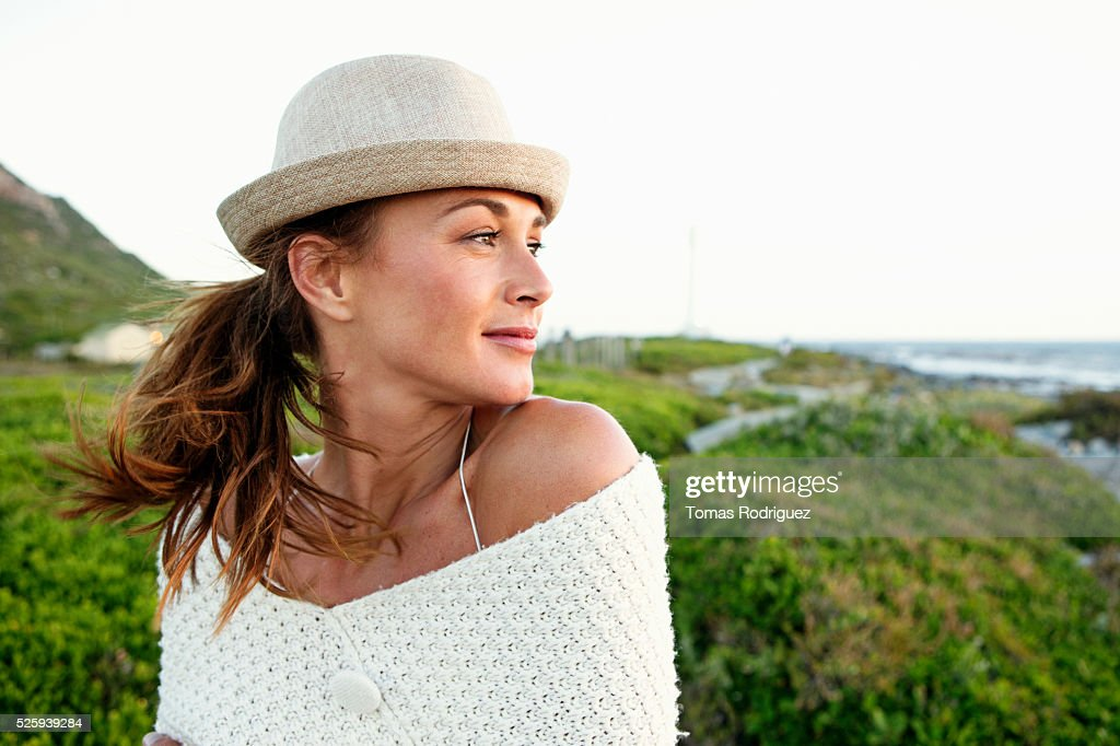 Portrait of young woman in summer clothes and hat : Foto de stock