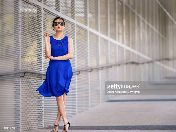 portrait of young woman in sunglasses - blue dress stock pictures, royalty-free photos & images