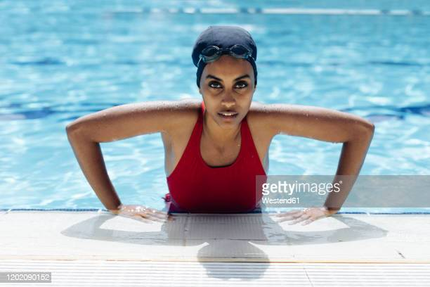 portrait of young woman in swimming  pool - getting out stock pictures, royalty-free photos & images