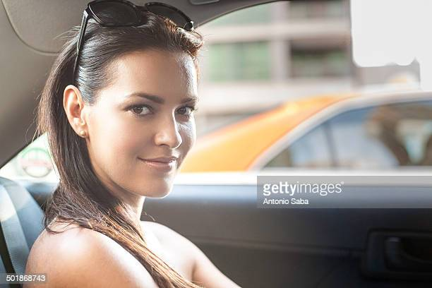 Portrait of young woman in taxi