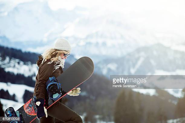 portrait of young woman in the snow - wintersport stockfoto's en -beelden