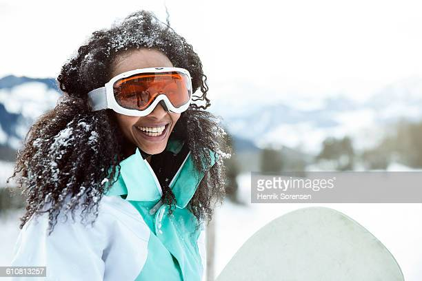 portrait of young woman in the snow - boarding stock pictures, royalty-free photos & images