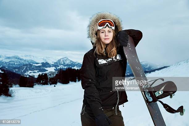 portrait of young woman in the snow - snowboarding stock pictures, royalty-free photos & images