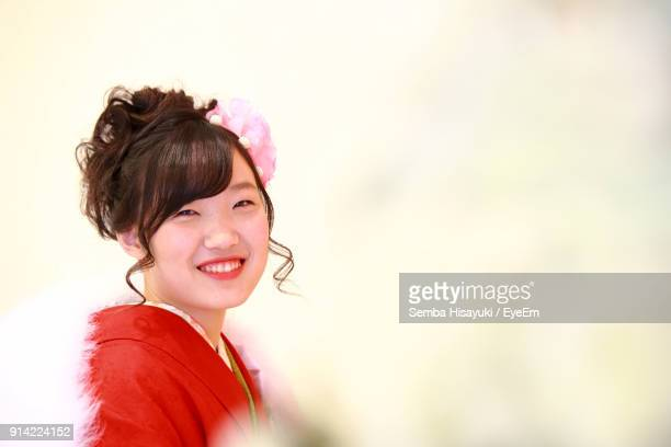 Portrait Of Young Woman In Traditional Clothing Against Wall