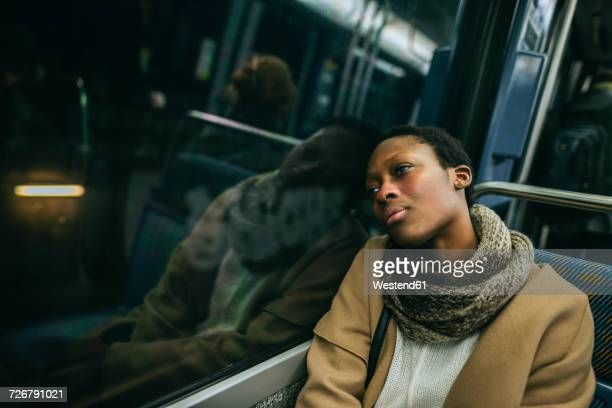 portrait of young woman in underground train - subway train stock pictures, royalty-free photos & images