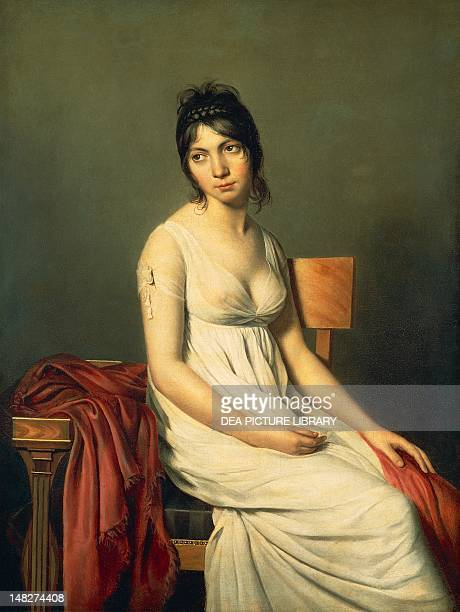 Portrait of young woman in white ca 1798 by an unknown artist from the JacquesLouis David School oil on canvas 1255x95 cm Washington National Gallery...