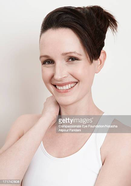 Portrait of young woman in white vest smiling