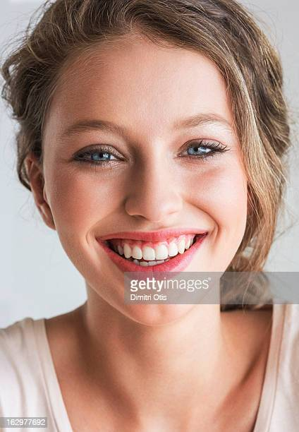 Portrait of young woman, laughing