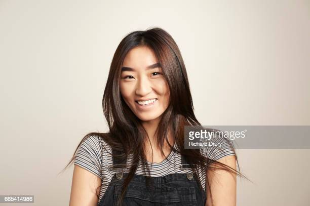 portrait of young woman laughing - striped shirt stock pictures, royalty-free photos & images