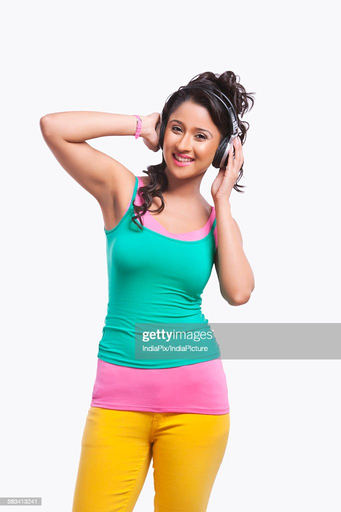 Portrait of young woman listening to music : Stock Photo