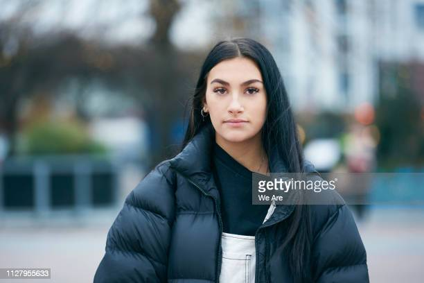 portrait of young woman looking at camera. - one young woman only stock pictures, royalty-free photos & images