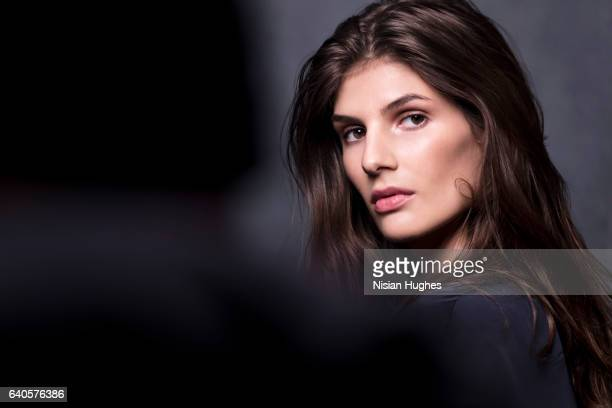 portrait of young woman looking at camera - brown hair stock pictures, royalty-free photos & images