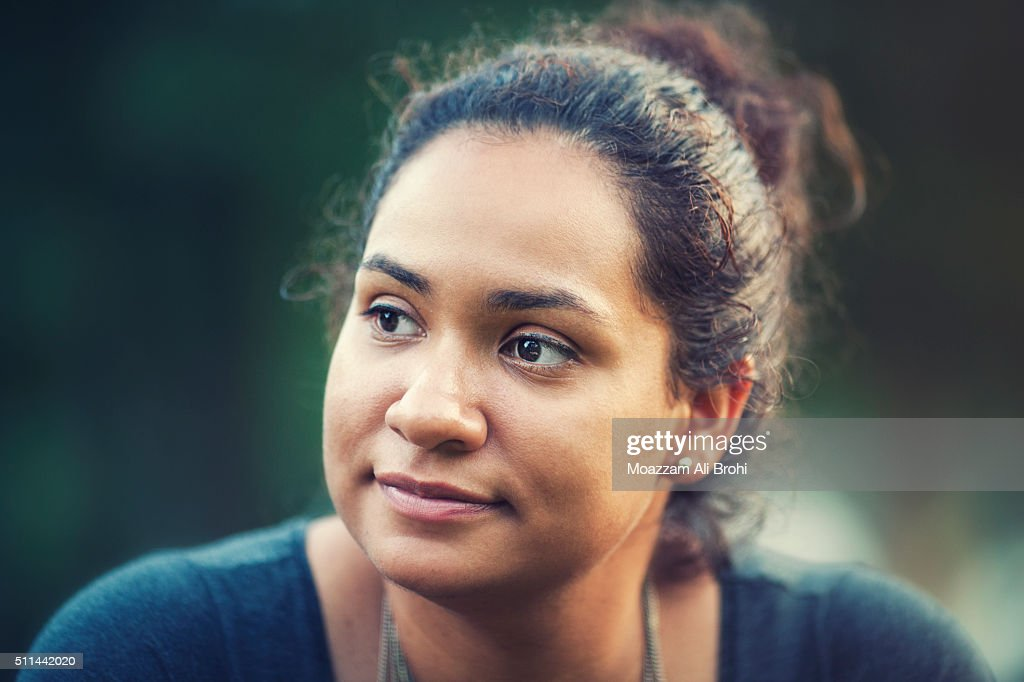Portrait of young woman looking away from camera : Stock Photo