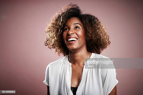 Portrait of young woman, looking away, laughing