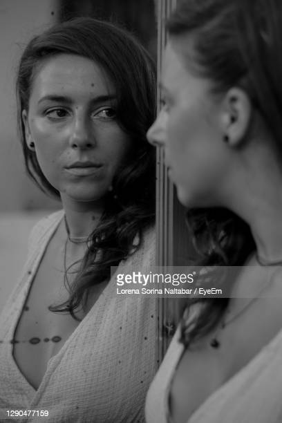 portrait of young woman looking away - lorena day stock pictures, royalty-free photos & images