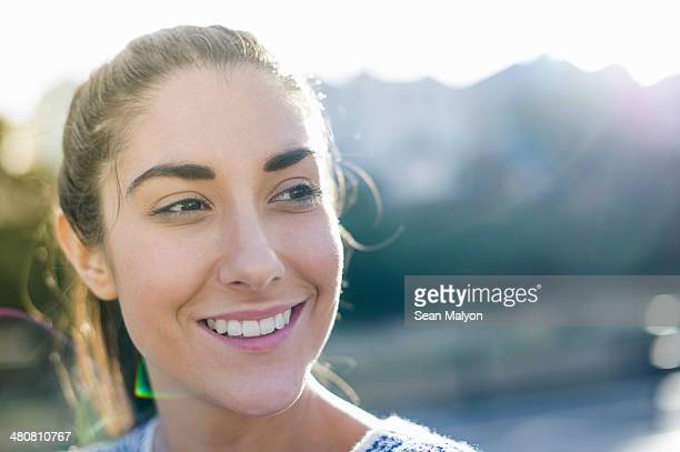 portrait of young woman looking away, smiling - sean malyon stock pictures, royalty-free photos & images