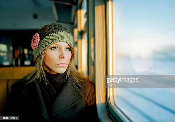 Portrait of Young Woman Looking Out Train Window