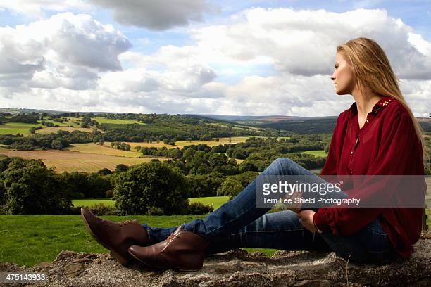 Portrait of young woman looking over rural landscape