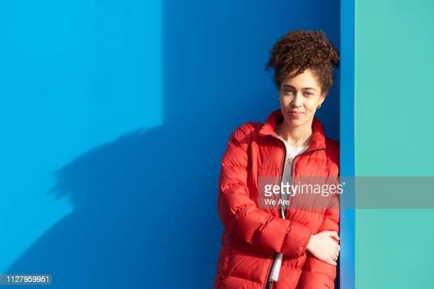 portrait of young woman looking to camera. - colour block stock pictures, royalty-free photos & images