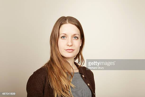 portrait of young woman looking to camera - serious stock pictures, royalty-free photos & images