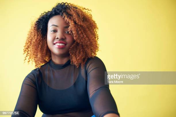 portrait of young woman looking to camera - voluptuous black women stock photos and pictures