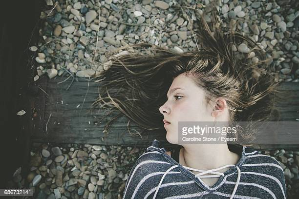 Portrait Of Young Woman Lying On Railway Track