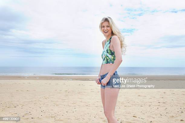 portrait of young woman on beach - blyth northumberland stock pictures, royalty-free photos & images