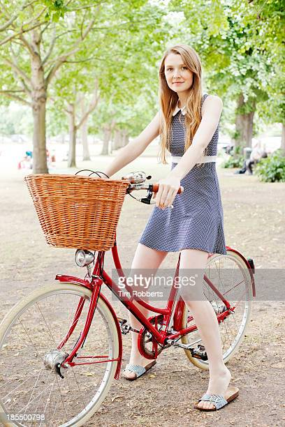 portrait of young woman on bike - mini dress stock pictures, royalty-free photos & images