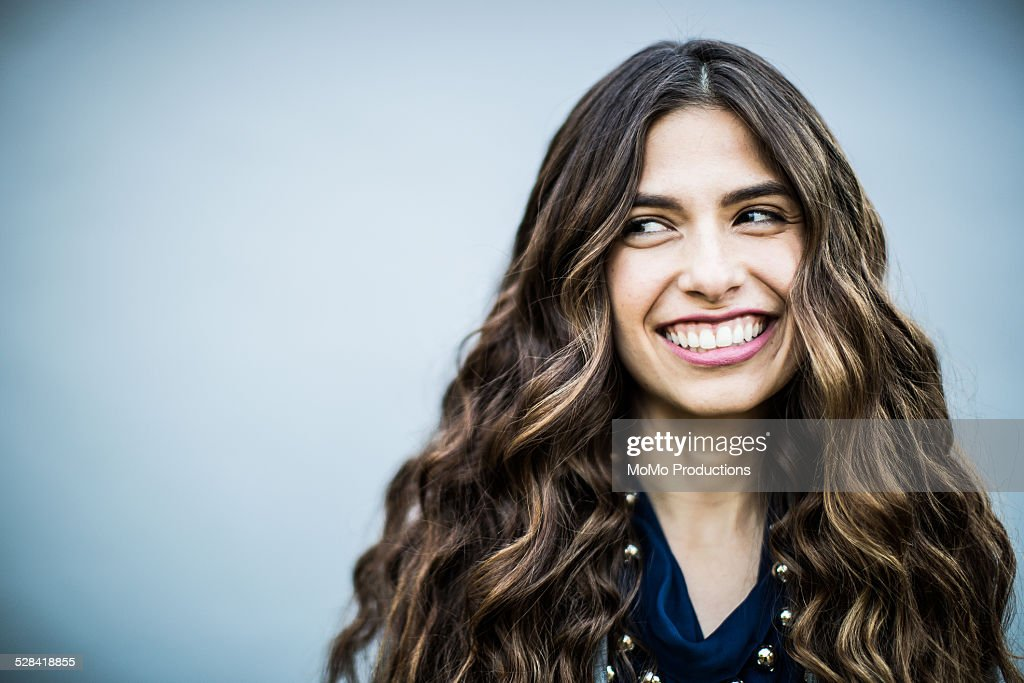 portrait of young woman on plain background : Stock Photo