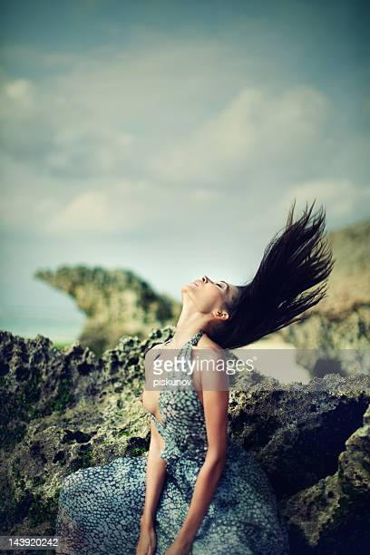 portrait of young woman on rocks - hot model indonesia stock pictures, royalty-free photos & images