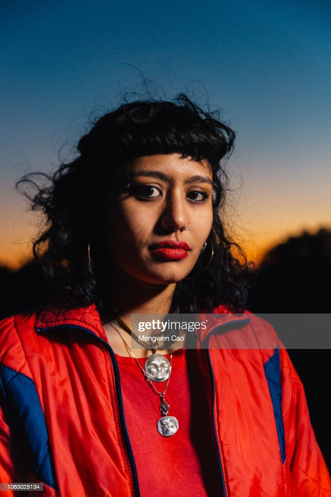 portrait of young woman on rooftop at sunset : Stock-Foto