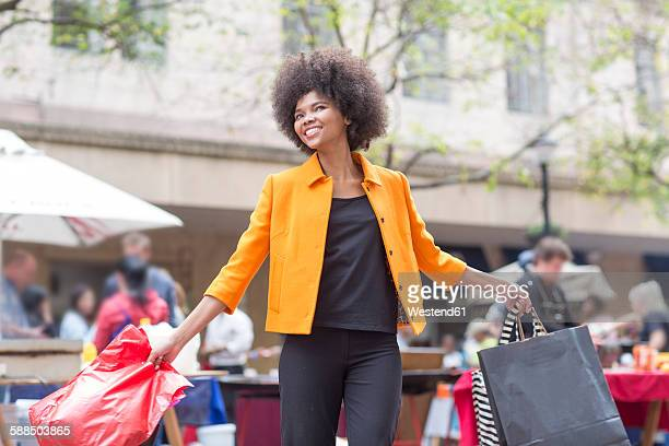 Portrait of young woman on shopping tour