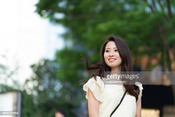 portrait of young woman on street - beautiful japanese women stock pictures, royalty-free photos & images